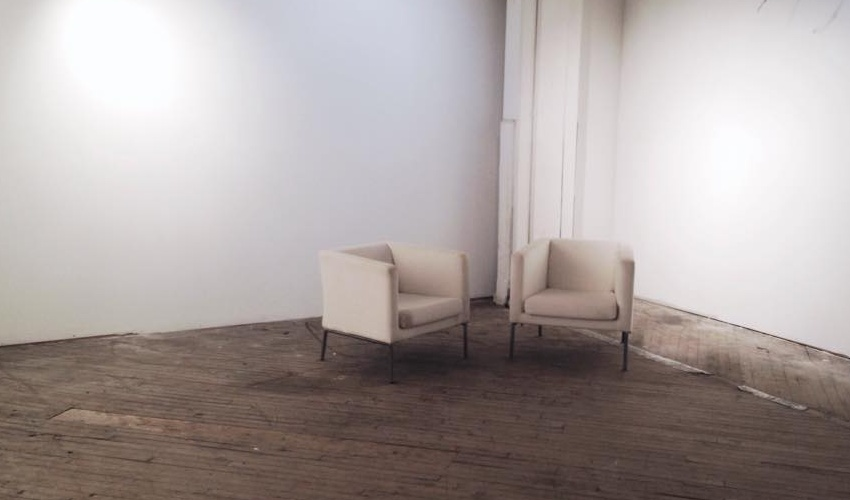 two chairs in ground floor gallery at 1241 Carpenter Street